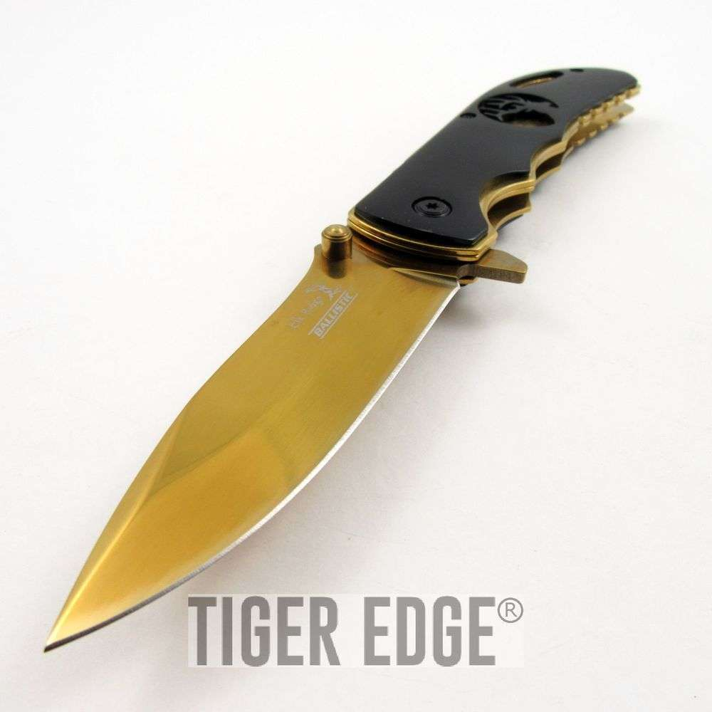 SPRING-ASSIST FOLDING ... Brass Knuckles Folding Knife