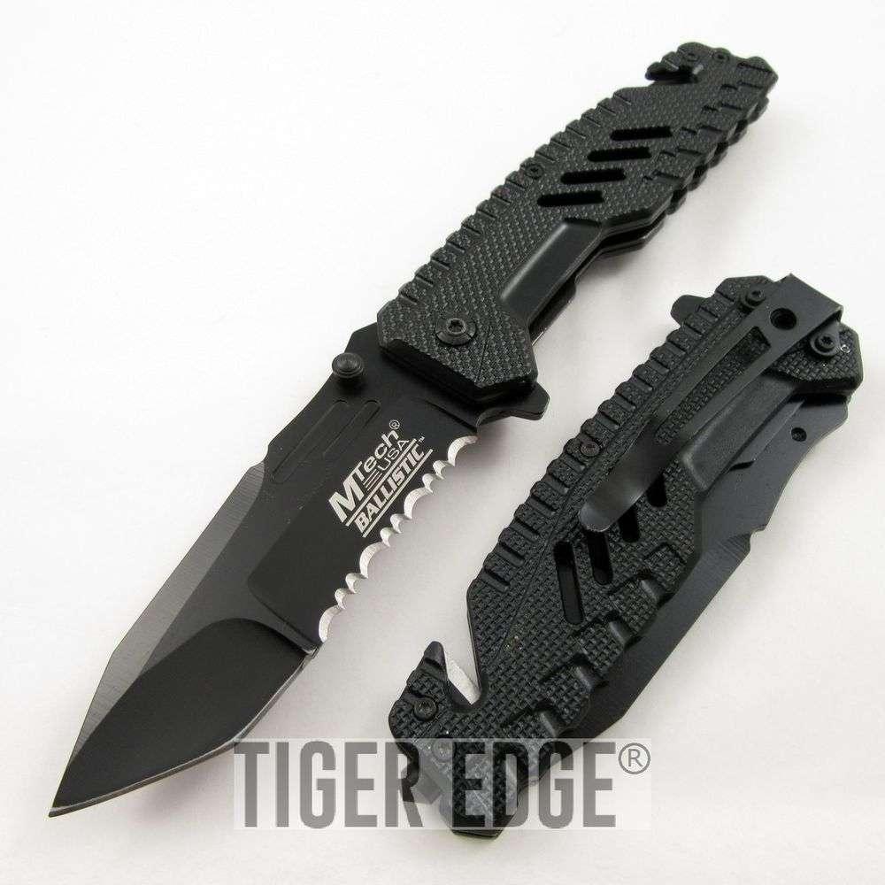 ... Spring-Assist Tactical Folding Knife Futuristic Black Serrated Tanto