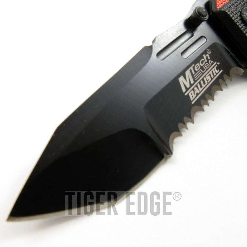 ... Spring-Assist Tactical Folding Knife Futuristic Orange Serrated Tanto
