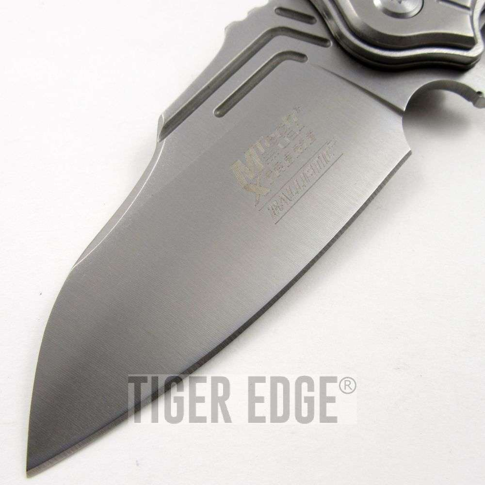 ... Xtreme Silver G10 Tactical Futuristic Spring Assist Folding Knife