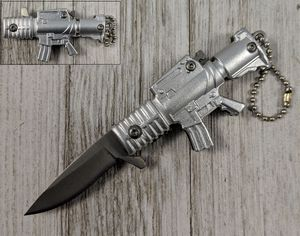 Spring-Assist Folding Keychain Knife | Mini Silver Military Assault Rifle 3